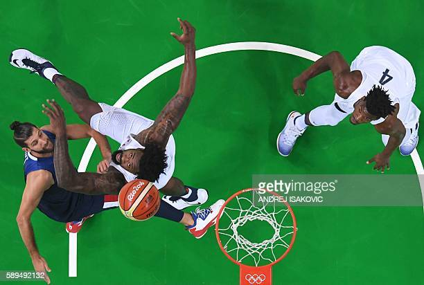 An overview shows France's point guard Antoine Diot USA's centre DeAndre Jordan and USA's forward Jimmy Butler eye a rebound during a Men's round...