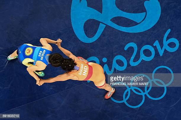 An overview shows India's Sakshi Malik wrestling with Kirghyzstan's Aisuluu Tynybekova in their women's 58kg freestyle bronze medal match on August...