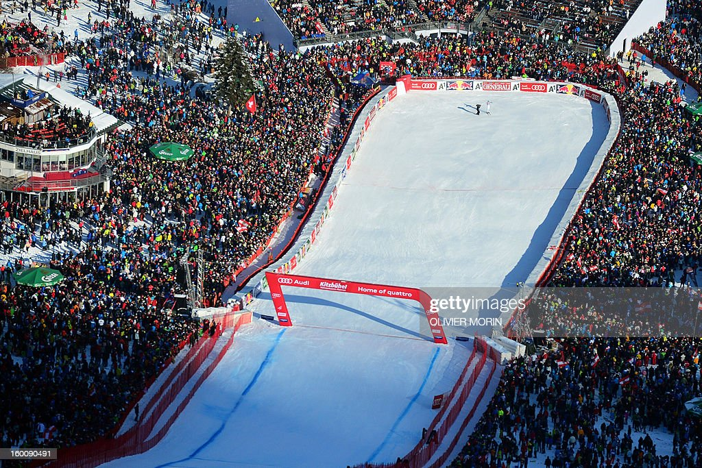 An overview shows Italy's Christof Innerhofer past the finishing line after he competed during the men's World Cup Downhill, on January 26, 2013 in Kitzbuehel, Austrian Alps. Italy's Dominik Paris won the event, Canada's Erik Guay finished second and Austria's Hannes Reichelt third.