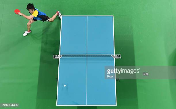 An overview shows Japan's Koki Niwa hitting a shot in his men's singles qualification round table tennis match at the Riocentro venue during the Rio...