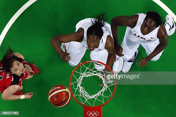 An overview shows Japan's point guard Asami Yoshida USA's centre Sylvia Fowles and USA's centre Tina Charles eye a rebound during a Women's...