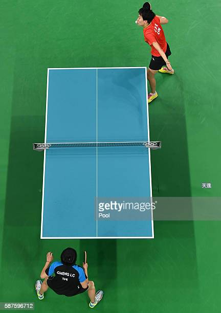 An overview shows Li Xiaoxia of China serving against Cheng IChing of Taiwan in their women's singles quarterfinal table tennis match at the...