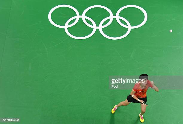 An overview shows Li Xiaoxia of China watching the ball as she celebrates a point against Cheng IChing of Taiwan in their women's singles...