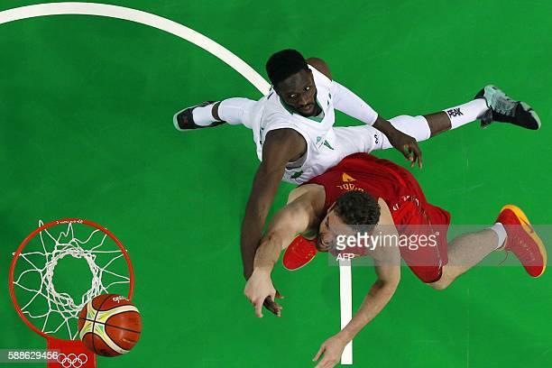 An overview shows Nigeria's centre Ekene Ibekwe and Spain's centre Pau Gasol go for a rebound during a Men's round Group B basketball match between...