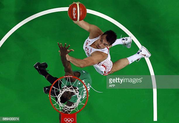 An overview shows Nigeria's centre Ekene Ibekwe defend against Croatia's forward Dario Saric during a Men's round Group B basketball match between...