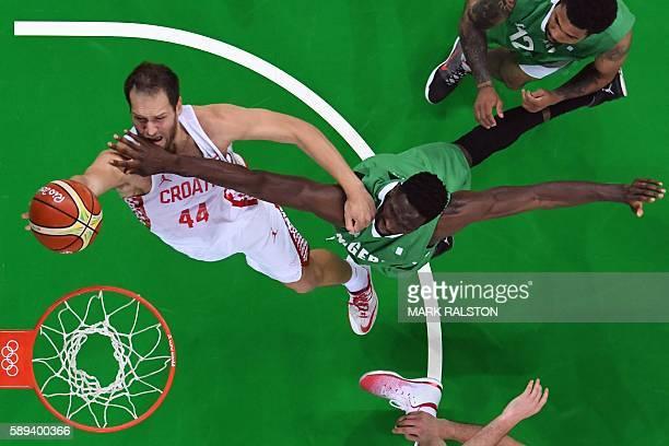 An overview shows Nigeria's centre Ekene Ibekwe defend against Croatia's shooting guard Bojan Bogdanovic during a Men's round Group B basketball...