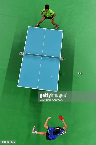 An overview shows Nigeria's Olofunke Oshonaike playing against Puerto Rico's Adriana Diaz in their women's singles qualification round table tennis...