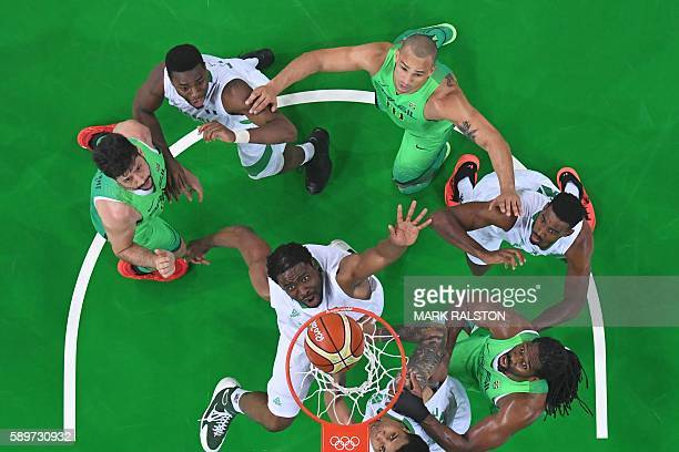 An overview shows Nigeria's power forward Ike Diogu Brazil's power forward Guilherme Giovannoni Brazil's small forward Alex Garcia and Brazil's...
