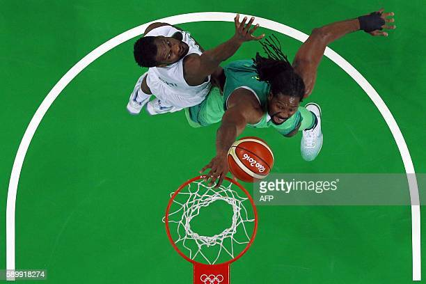 An overview shows Nigeria's shooting guard Chamberlain Oguchi defend against Brazil's centre Nene Hilario during a Men's round Group B basketball...