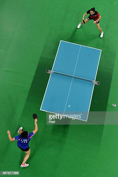 An overview shows North Korea's Kim Song I hitting a shot against Singapore's Yu Mengyu in their women's singles quarterfinal table tennis match at...
