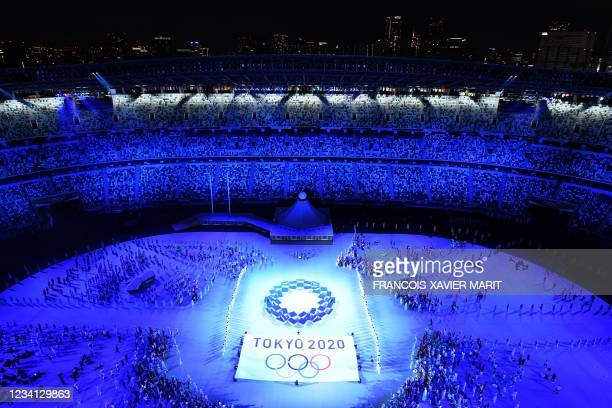 An overview shows performers and athlete delegations taking part in the opening ceremony of the Tokyo 2020 Olympic Games, at the Olympic Stadium, in...