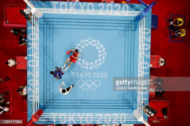 An overview shows Refugee Olympic Team's Wessam Salamana falling as he fights Brazil's Wanderson De Oliveira during their men's light preliminaries...