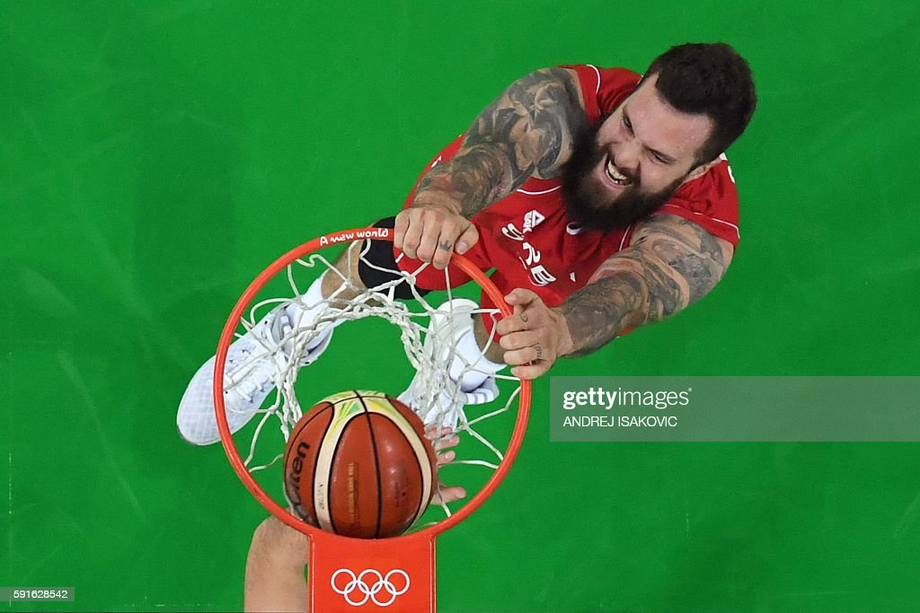 TOPSHOT - An overview shows Serbia's centre Miroslav Raduljica dunk during a Men's quarter final basketball match between Croatia and Serbia at the Carioca Arena 1 in Rio de Janeiro on August 17, 2016 during the Rio 2016 Olympic Games. / AFP / Andrej ISAKOVIC