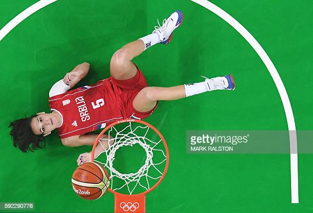TOPSHOT An overview shows Serbia's forward Sonja Petrovic lying on the floor during the Women's Bronze medal basketball match between Serbia and...