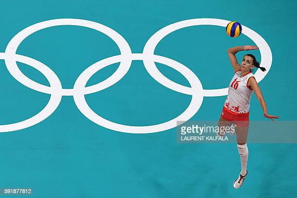 An overview shows Serbia's Milena Rasic serving the ball during the women's semifinal volleyball match between Serbia and USA at the Maracanazinho...