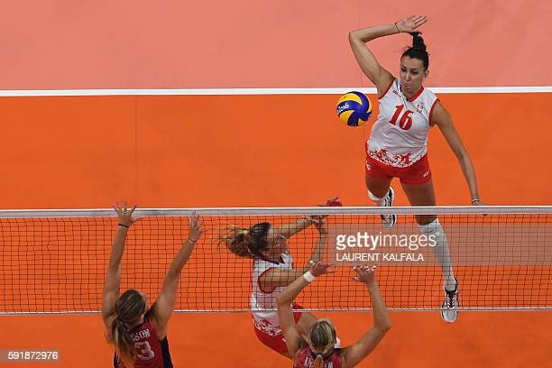An overview shows Serbia's Milena Rasic spiking the ball during the women's semifinal volleyball match between Serbia and USA at the Maracanazinho...