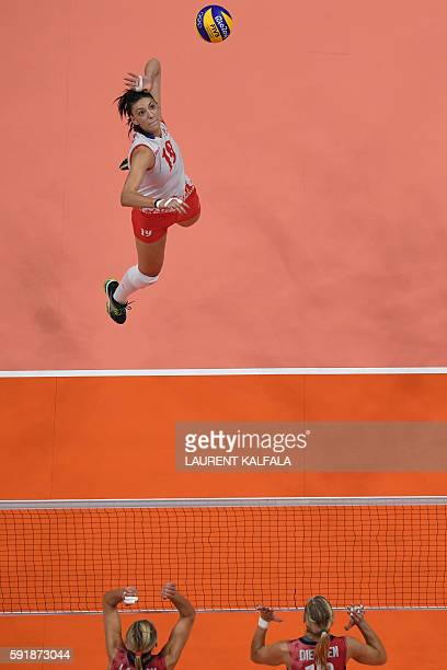 An overview shows Serbia's Tijana Boskovic spiking the ball during the women's semifinal volleyball match between Serbia and USA at the Maracanazinho...