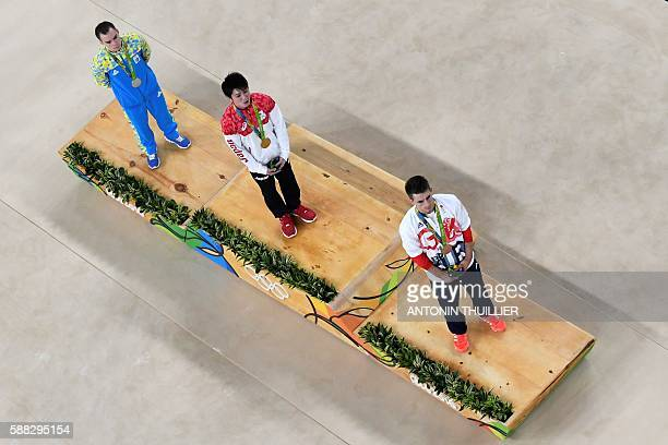 An overview shows silver medallist Ukraine's Oleg Verniaiev gold medallist Japan's Kohei Uchimura and bronze medallist Britain's Max Whitlock on the...