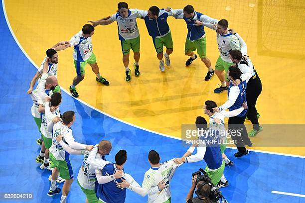 TOPSHOT An overview shows Slovenia's players celebrating after winning the 25th IHF Men's World Championship 2017 quarter final handball match...