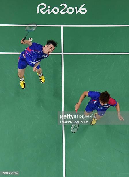 An overview shows South Korea's Yoo Yeon Seong and South Korea's Lee Yong Dae serve to Taiwan's Sheng Mu Lee and Taiwan's Chia Hsin Tsai during their...