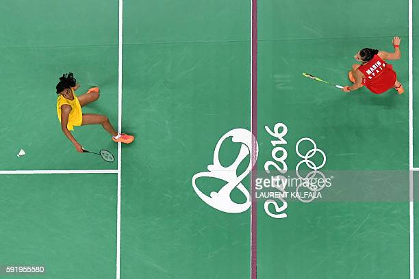 An overview shows Spain's Carolina Marin returns against India's Pusarla V Sindhu during their women's singles Gold Medal badminton match at the...