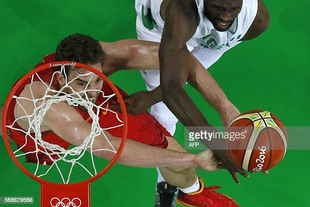 An overview shows Spain's centre Pau Gasol and Nigeria's centre Ekene Ibekwe go for a rebound during a Men's round Group B basketball match between...