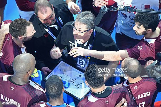TOPSHOT An overview shows Spanish Qatar's head coach Valero Rivera speaking to his players during the 25th IHF Men's World Championship 2017 quarter...