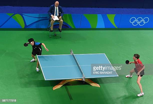 An overview shows Taiwan's Cheng IChing playing against Belarus' Viktoria Pavlovich in their women's singles qualification round table tennis match...