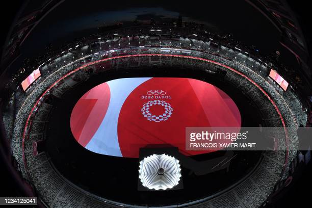 An overview shows the Tokyo 2020 emblem and the stage ahead of the opening ceremony of the Tokyo 2020 Olympic Games, at the Olympic Stadium, in...