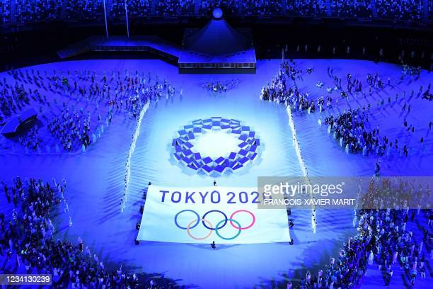 An overview shows the Tokyo 2020 emblem during the opening ceremony of the Tokyo 2020 Olympic Games, at the Olympic Stadium, in Tokyo, on July 23,...