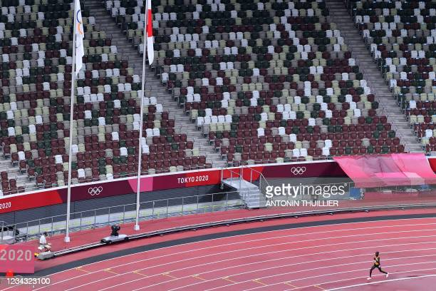 An overview shows Uganda's Stephen Kissa competing in the men's 10000m final during the Tokyo 2020 Olympic Games at the Olympic Stadium in Tokyo on...