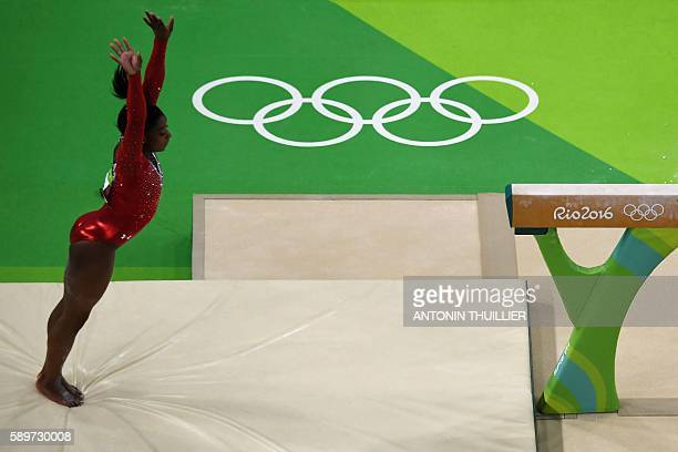 An overview shows US gymnast Simone Biles competing in the women's balance beam event final of the Artistic Gymnastics at the Olympic Arena during...