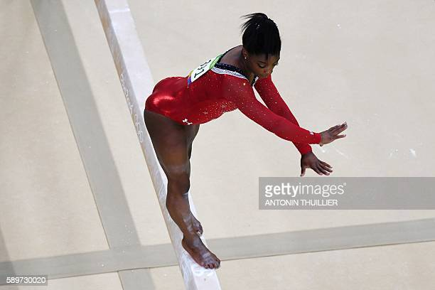 TOPSHOT An overview shows US gymnast Simone Biles competing in the women's balance beam event final of the Artistic Gymnastics at the Olympic Arena...