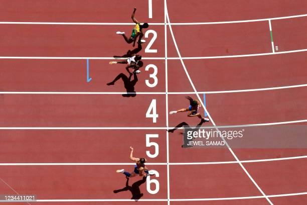 An overview shows USA's Allyson Felix crossing the finish line to win ahead of second-placed Jamaica's Roneisha McGregor , third-placed Czech...