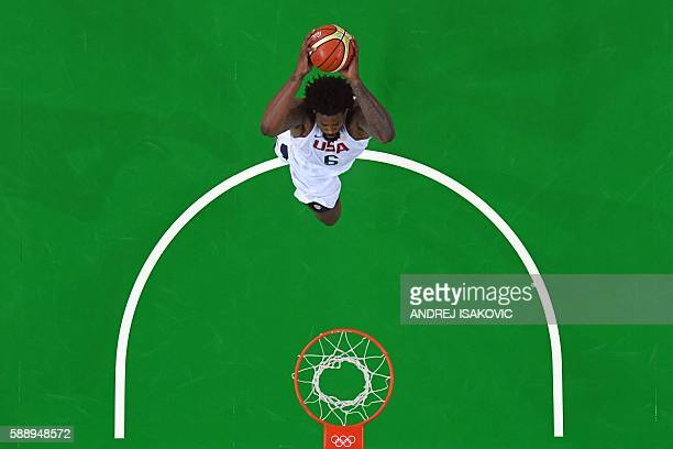 TOPSHOT An overview shows USA's centre DeAndre Jordan score during a Men's round Group A basketball match between USA and Serbia at the Carioca Arena...