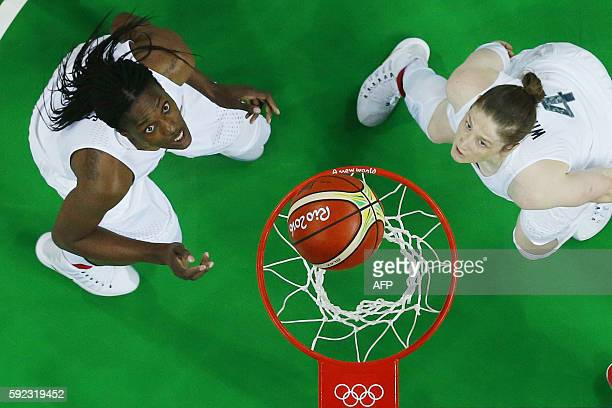An overview shows USA's centre Sylvia Fowles and USA's guard Lindsay Whalen watching the ball during a Women's Gold medal basketball match between...