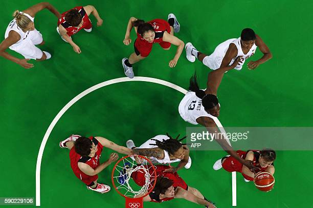 An overview shows USA's centre Sylvia Fowles defend against Japan's small forward Mika Kurihara during a Women's quarterfinal basketball match...
