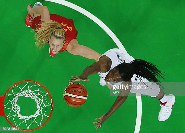 An overview shows USA's centre Sylvia Fowles jumping for a basket by Spain's power forward Laura Gil during a Women's Gold medal basketball match...