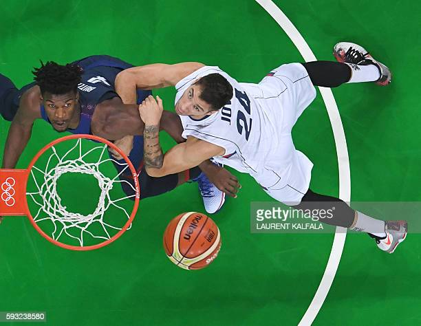 An overview shows USA's forward Jimmy Butler and Serbia's guard Stefan Jovic watching the ball during a Men's Gold medal basketball match between...