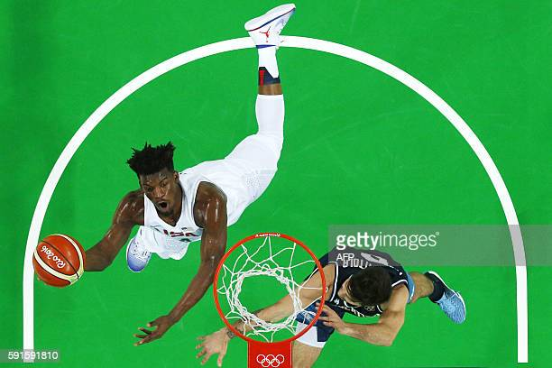 An overview shows USA's forward Jimmy Butler scoring past Argentina's point guard Nicolas Laprovittola during a Men's quarterfinal basketball match...