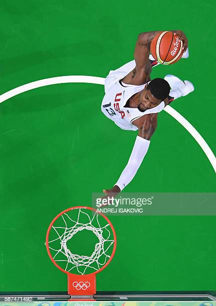 An overview shows USA's guard Paul George slam dunking during a Men's round Group A basketball match between USA and Venezuela at the Carioca Arena 1...