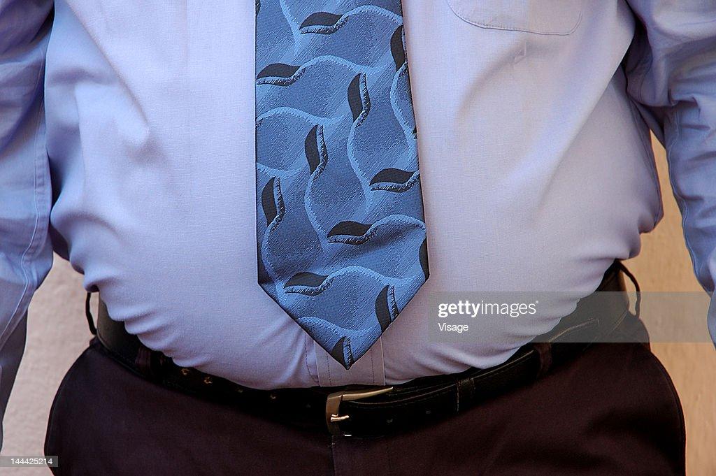 An overweight businessman : Stock Photo