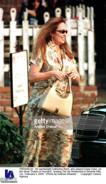 An overweight Catherine Bach who played Daisy Duke on the show Dukes of Hazzard leaving The Ivy Restaurant in Beverly Hills Ca February 3 2000