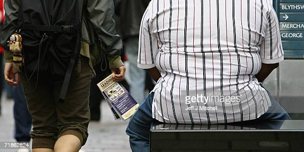 An overweight person sits on a bench in Glasgow City centre September 12, 2006 in Scotland. A forecast report on UK obesity trends states that a...