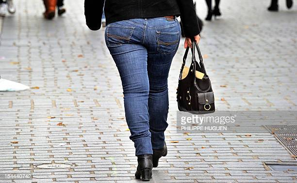 An overweight person walks in a street of the northern city of Lille on October 19, 2012. AFP PHOTO PHILIPPE HUGUEN