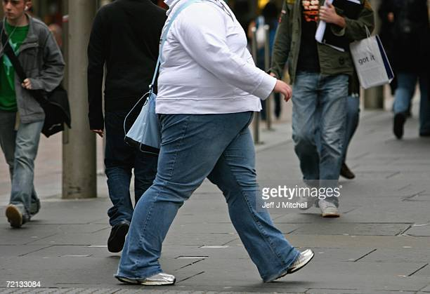 An overweight person walks through Glasgow city centre on October 10, 2006 in Glasgow, Scotland. According to government health maps published today,...