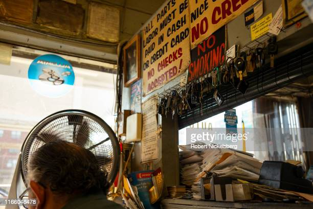 An owner of the J & E Service Station sits at a desk in the Brooklyn borough of New York City on July 30, 2019.