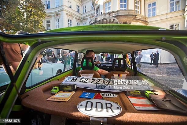 An owner of the Trabantbrand car poses as he arrives at a commemoration event to the 25th anniversary of refugee exodus from communist East Germany...