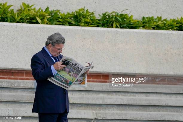 An owner reads the industry newspaper at Goodwood Racecourse on July 28 2020 in Chichester England Owners are allowed to attend if they have a runner...