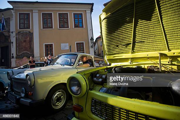An owner sits in his Trabantbrand car as he arrives at a commemoration event to the 25th anniversary of refugee exodus from communist East Germany in...